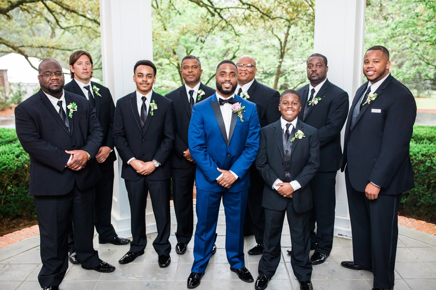 group photo of all the groomsmen and the groom