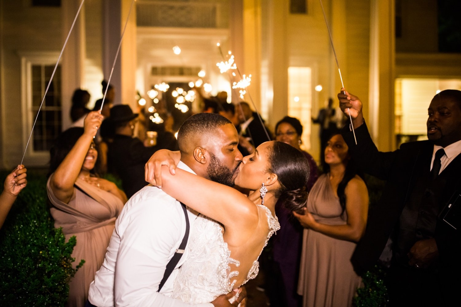 bride and groom kiss during the reception sparkler exit