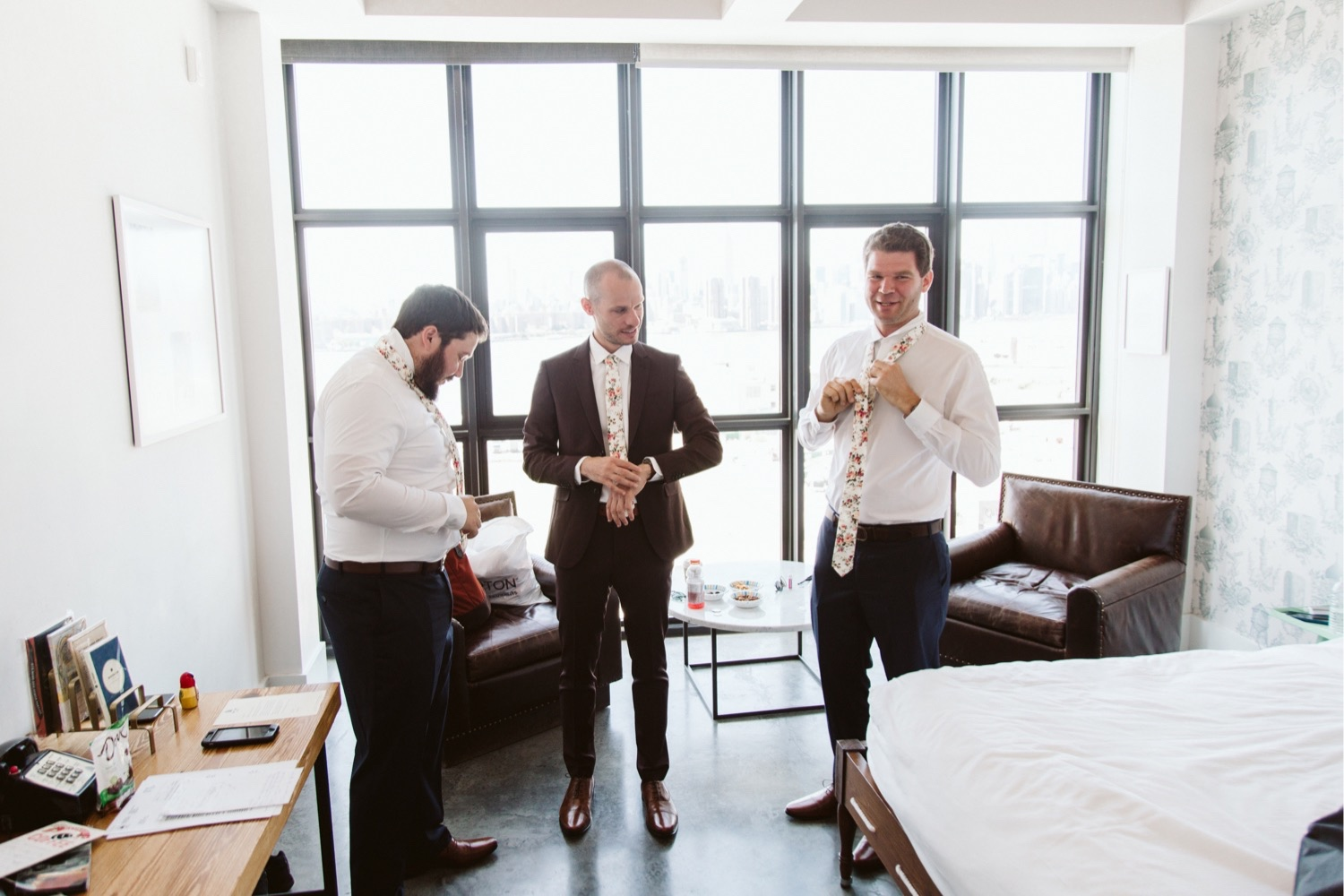 the groom and groomsmen in the wythe hotel getting ready