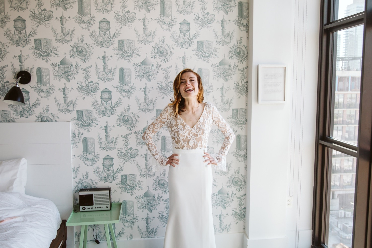 the bride laughing at her incredibly funny and talented brooklyn wedding photographer