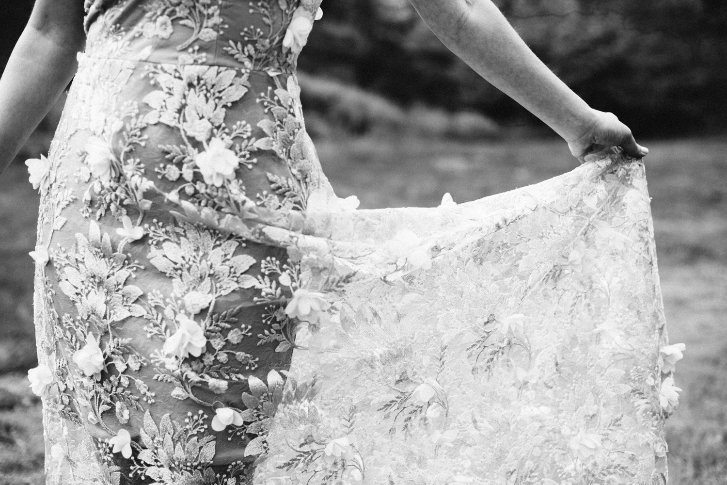 close up shot of the dress during the wedding day worn by the bride as she dances in a field at NYBG