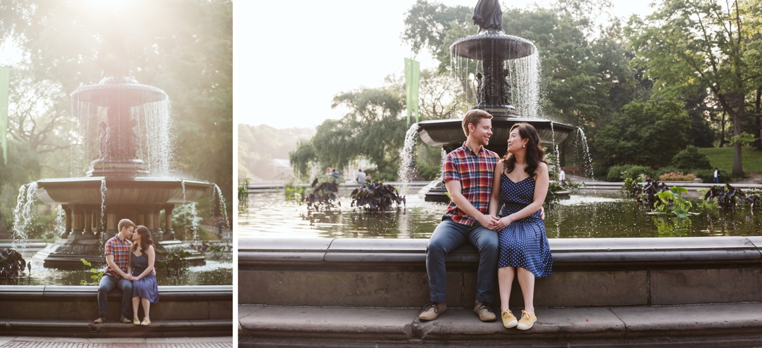engaged couple sits on the edge of bethesda fountain in central park for their engagement session