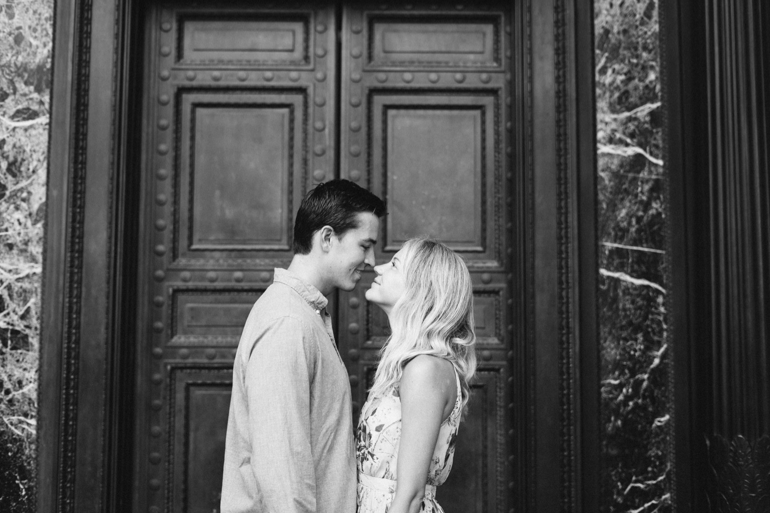 black and white photo of couple looking at each other during their engagement session
