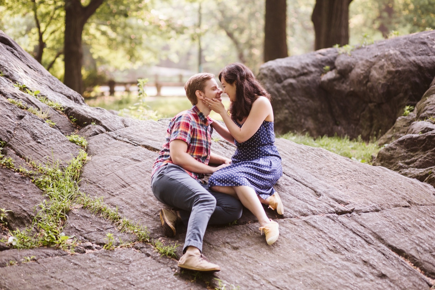 couple embracing on rocks in the park