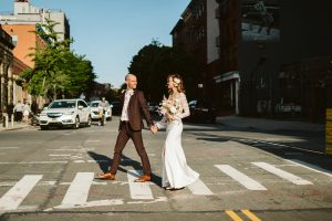 wedding couple crossing the street in Williamsburg