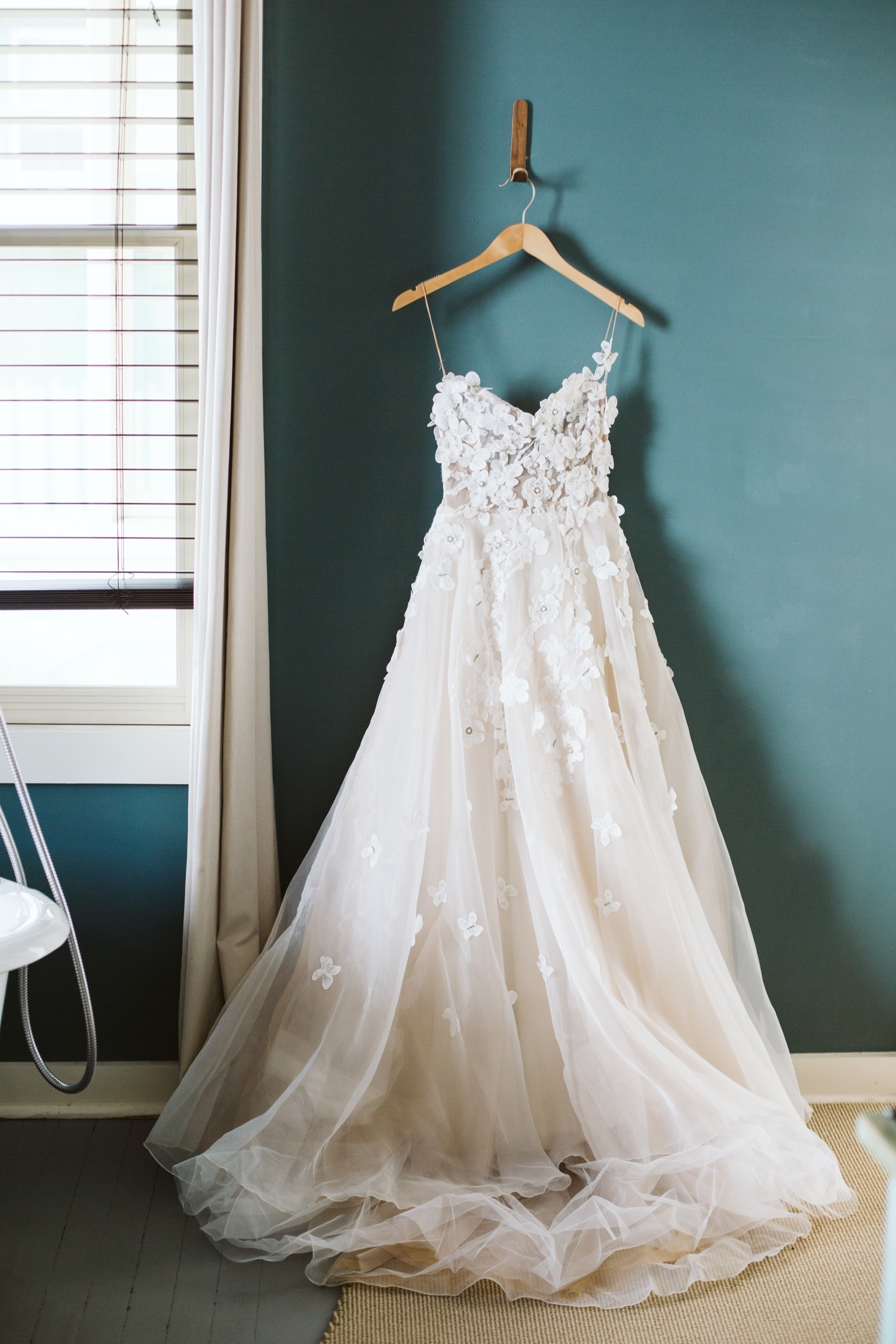 Our story bridal wedding dress wedding gown hanging in the bridal suite