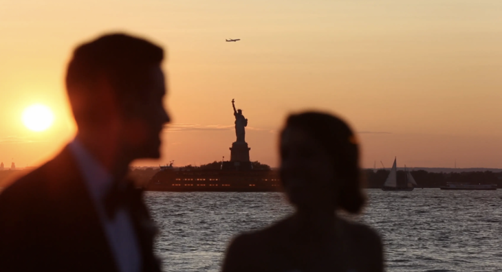 Liberty Warehouse Wedding Venue in Brooklyn. Liberty Warehouse Wedding Video by Natura Collective. Sunset view of Statue of Liberty from the wedding location.