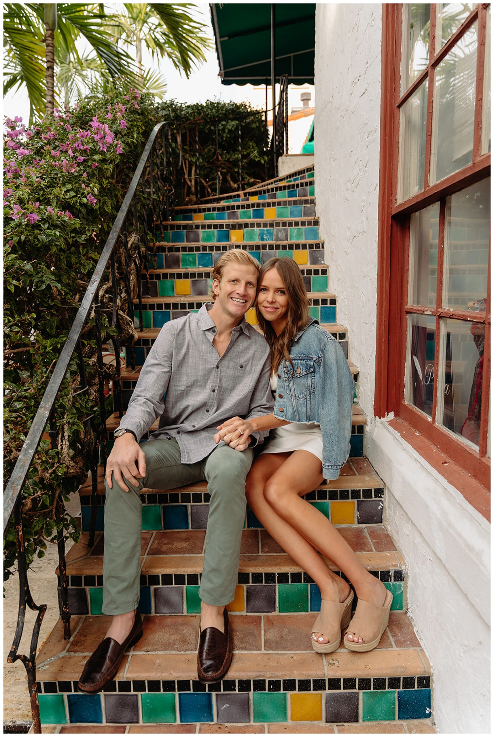 couple sitting on staircase in palm beach