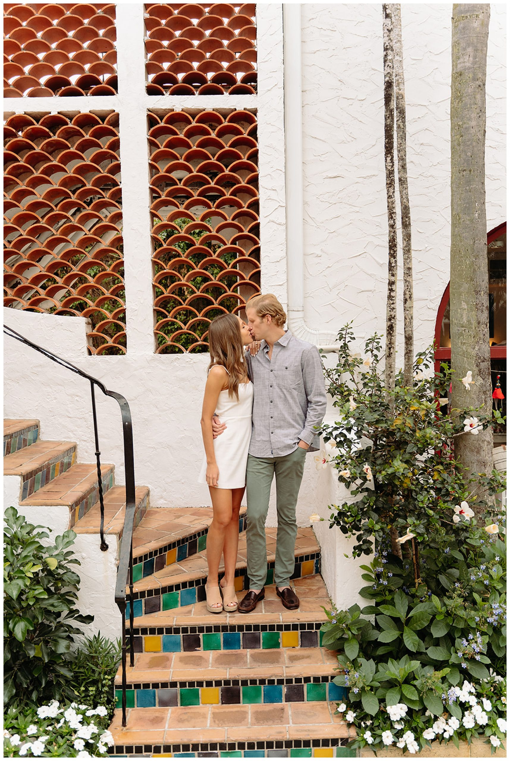couple kissing on staircase